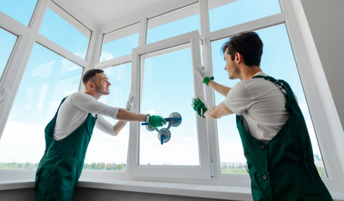Two young men installing window